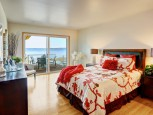 ocean-front-bedroom-with-slider-door-view-and-deck